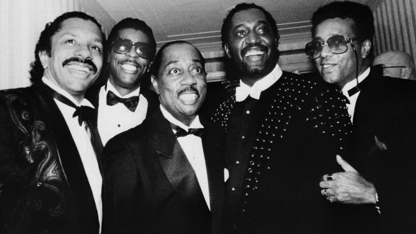 The Temptations pose for photographers as they enter New York's Waldorf-Astoria Hotel for their induction into the Rock and Roll Hall of Fame, Jan. 18, 1989. Only Melvin Franklin, center, and Otis Williams, second from right, the remaining members from the vocal group's original lineup, were to be inducted. The group's present lineup is made up of, from left, Ron Tyson, Ali Ollie Woodson, Franklin, Williams, and Richard Street. (AP Photo/Frankie Ziths)